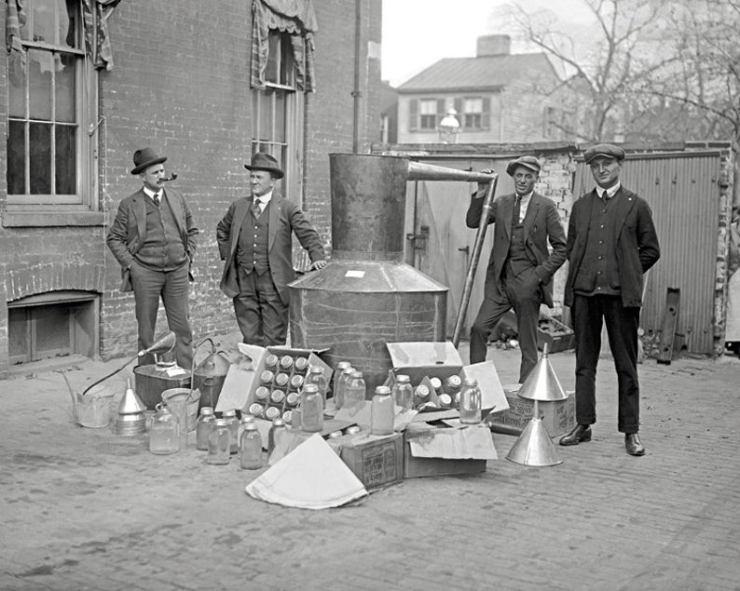 Prohibition agents with moonshine still, circa 1921